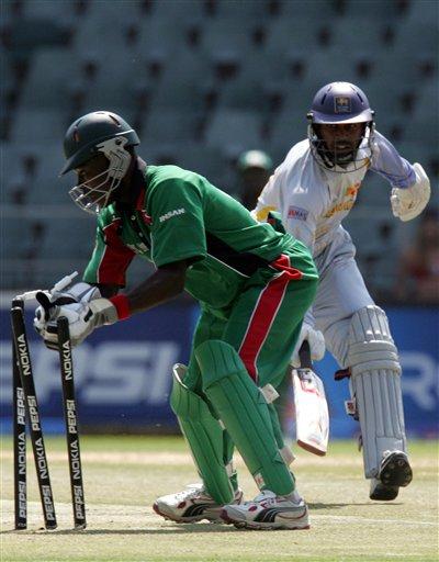 Kenya's wicketkeeper Maurice Ouma, left, runs out Sri Lanka' batsman Chamara Silva, right, for 5 runs during the Twenty20 World Championship cricket at the Wanderers Stadium in Johannesburg, South Africa, Friday, Sept. 14, 2007.
