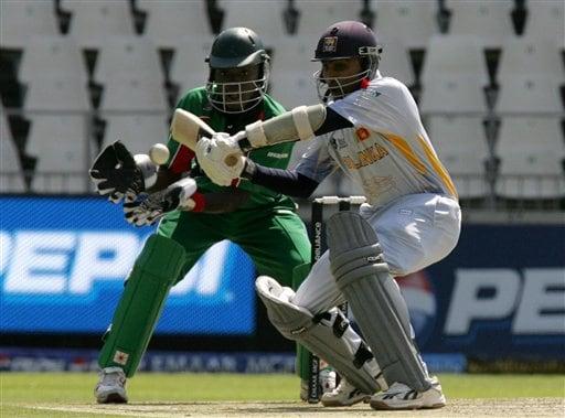 Sri Lanka's captain Mahela Jayawardene, right, plays a shot as Kenya's wicketkeeper Maurice Ouma, left, looks on during the Twenty20 World Championship cricket at the Wanderers Stadium in Johannesburg, South Africa, Friday, Sept. 14, 2007.