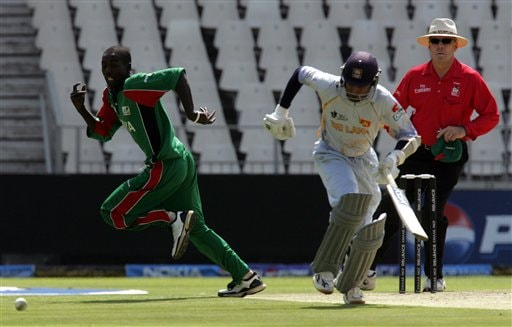 Kenya's bowler Jimmy Kamande, left, chases the ball as Sri Lanka's captain Mahela Jayawardene, center, runs during the Twenty20 World Championship cricket against Sri Lanka at the Wanderers Stadium in Johannesburg, South Africa, Friday, Sept. 14, 2007. Umpire Daryl Harper of Australia looks on at right.
