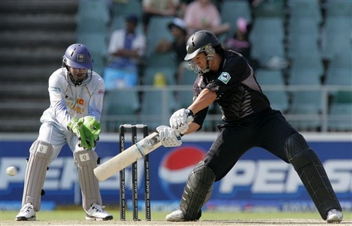 New Zealand's batsman Ross Taylor, right, plays a shot while Sri Lanka's wicketkeeper, Kumar Sangakkara, left, looks on during their Twenty20 World Championship cricket match at the Wanderers Stadium in Johannesburg, South Africa, Saturday, Sept. 15, 2007