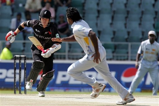 New Zealand's batsman Lou Vincent, left, makes a run as Sri Lanka's bowler Dilhara Fernando, center, chases the ball whilst teammate Sanath Jayasuriya, right, looks on during their Twenty20 World Championship cricket against Sri Lanka at the Wanderers Stadium in Johannesburg, South Africa, Saturday, Sept. 15, 2007.