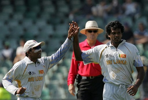 Sri Lanka's captain Mahela Jayawardene, left, congratulates his bowler Dilhara Fernando, right, for dismissing New Zealand's batsman Lou Vincent, unseen, for 14 runs as umpire Daryl Harper of Australia, center, looks on during their Twenty20 World Championship cricket against New Zealand at the Wanderers Stadium in Johannesburg, South Africa, Saturday, Sept. 15, 2007.