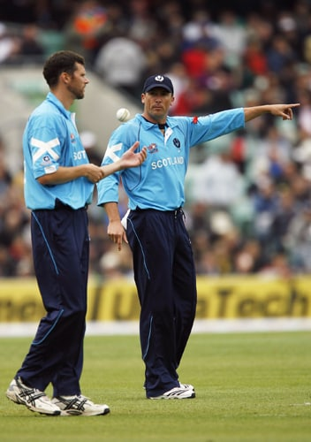 Gavin Hamilton of Scotland gives instructions to Calum MacLeod during their ICC World Twenty20 match against New Zealand at The Oval in London. (AFP Photo)