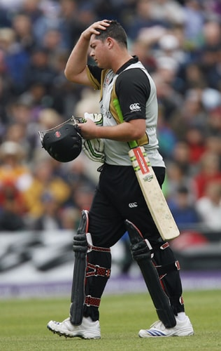 New Zealand's Jesse Ryder walks off after being caught by Scotland's Calum MacLeod during their ICC World Twenty20 match against Scotland at The Oval in London. (AFP Photo)