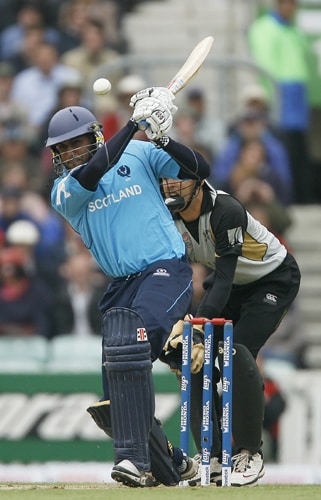 Navdeep Poonia of Scotland hits the ball during their ICC World Twenty20 match against New Zealand at The Oval in London. (AFP Photo)