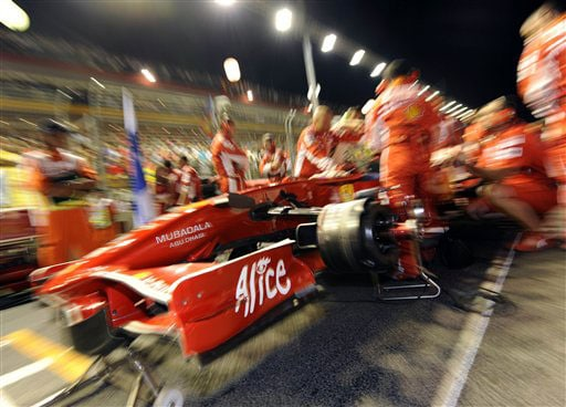 The Ferrari crew swarm the car of Felipe Massa of Brazil just minutes prior to the start of the Singapore Formula One Grand Prix on the Marina Bay City Circuit in Singapore on Sunday.