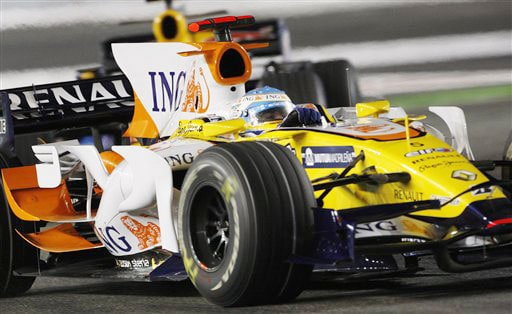 Renault driver Fernando Alonso of Spain takes a turn during the Singapore Formula One Grand Prix on the Marina Bay City Circuit in Singapore on Sunday.