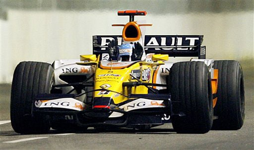 Renault Formula One driver Fernando Alonso of Spain waves after crossing the finish line to win the Marina Bay City Circuit during the Singapore Grand Prix on Sunday.
