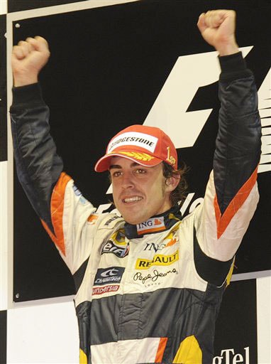 Renault Formula One driver Fernando Alonso of Spain celebrates after he won the Singapore Formula One Grand Prix on the Marina Bay City Circuit in Singapore on Sunday.