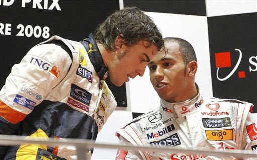McLaren Mercedes Formula One driver Lewis Hamilton of Britain, right, chats with Renault Formula One driver Fernando Alonso of Spain after Alonso won the Singapore Formula One Grand Prix.