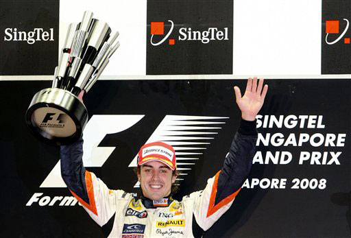 Renault Formula One driver Fernando Alonso of Spain holds the champions trophy during the award ceremony of the first ever night Formula One race Singapore Grand Prix at Marina Bay City Circuit in Singapore on Sunday.