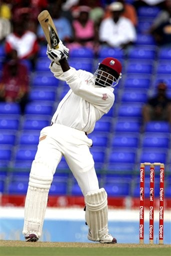West Indies batsman Chris Gayle hits a six off the bowling of India's SSreesanth, not seen, on the first day of the third cricket test match at St. Kitts.
