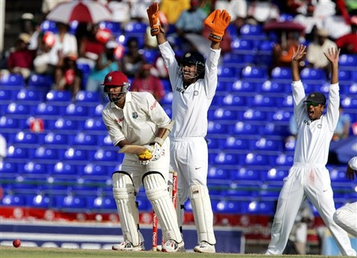 India's wicketkeeper Mahendra Dhoni, center, and captain Rahul Dravid, right, make an unsuccessfull LBW appeal on West Indies batsman Daren Ganga, left, on the first day of the third cricket test match at St. Kitts.