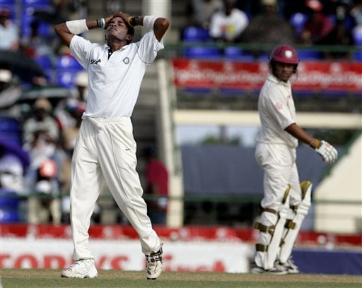 India's bowler S Sreesanth, left, reacts after missing the wicket of West Indies batsman Chris Gayle, not seen, on the first day of the third cricket test match St. Kitts.