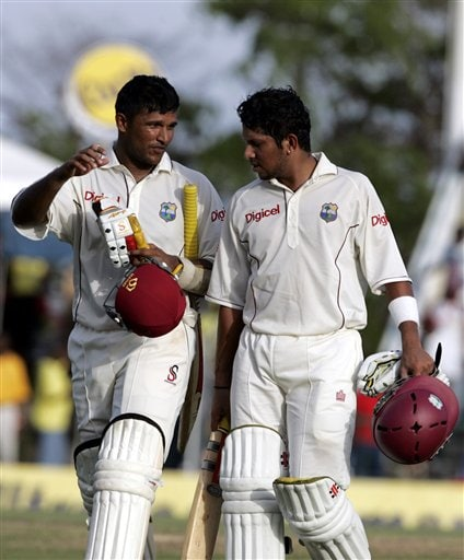 West Indies batsmen Daren Ganga, left, and Ramnaresh Sarwan, right, walk off the field on the first day of the third cricket test match against India at St. Kitts.