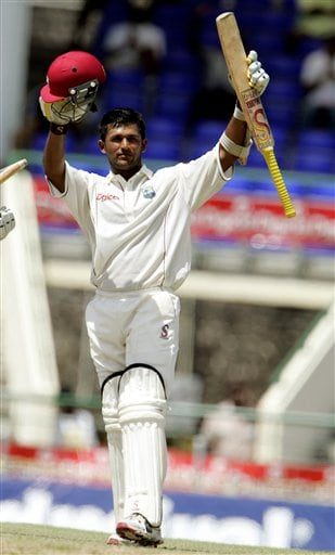 West Indies batsman Daren Ganga raises his bat after scoring a century against India on the second day of the third cricket test match at St. Kitts.
