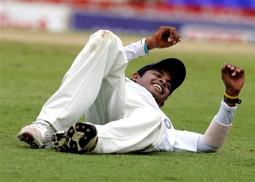 India's bowler S Sreesanth stretches off in between overs on the second day of the third cricket test match against the West Indies at St. Kitts.