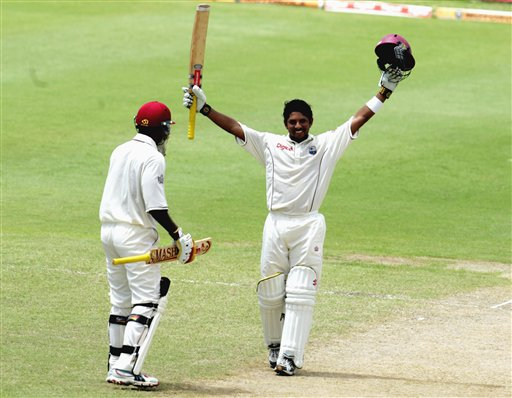 West Indies batsman Ramnaresh Sarwan, right, celebrates after scoring a century against India on the second day of the third cricket test match at St. Kitts.