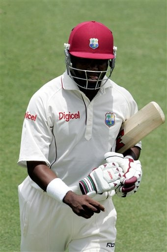 West Indies batsman Brian Lara walks off the field after being out LBW for 10 runs off the bowling of India's Munaf Patel on the second day of the third cricket test match at St. Kitts.