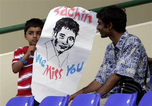 An Indian cricket fan holds up a sign, which reads 'Sachin We Miss You', on the third day of the third cricket Test match between the West Indies and India at Warner Park in Basseterre, St Kitts, Saturday, June 24, 2006. Indian batsman Sachin Tendulkar is not on India's tour of the Caribbean as he was recovering from a shoulder injury at the start of the tour. (AP Photo/Lynne Sladky)