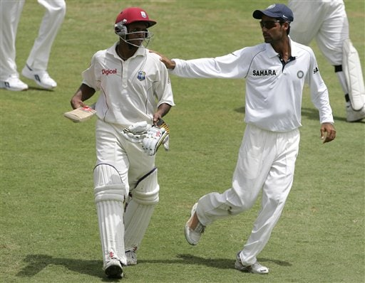 West Indies batsman Shivnarine Chanderpaul, left, walks off the field as India's Mohammad Kaif, right, puts his hand on his shoulder at the end of the West Indies' first innings on the third day of the third cricket Test match at Warner Park in Basseterre, St Kitts, Saturday, June 24, 2006. Chanderpaul fell three runs short of scoring a century as West Indies were 581 for 10. (AP Photo/Lynne Sladky)