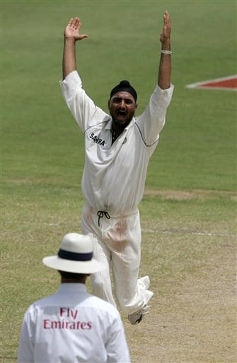 India's spin bowler Harbhajan Singh, top, makes an unsuccessful LBW appeal on West Indies batsman Corey Collymore on the third day of the third cricket Test match at Warner Park in Basseterre, St Kitts, Saturday, June 24, 2006. Singh had five wickets for 147 runs. (AP Photo/Lynne Sladky)