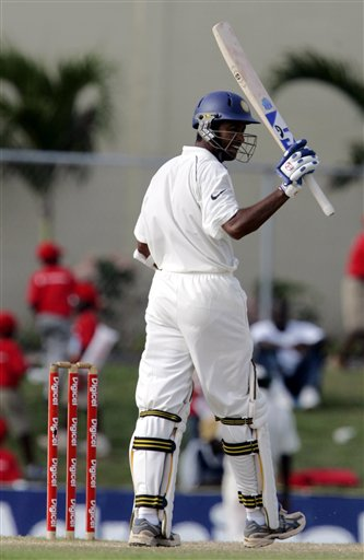 India's batsman Wasim Jaffer raises his bat after scoring a half century against the West Indies on the third day of the third cricket Test match at Warner Park in Basseterre, St Kitts, Saturday, June 24, 2006. (AP Photo/Lynne Sladky)
