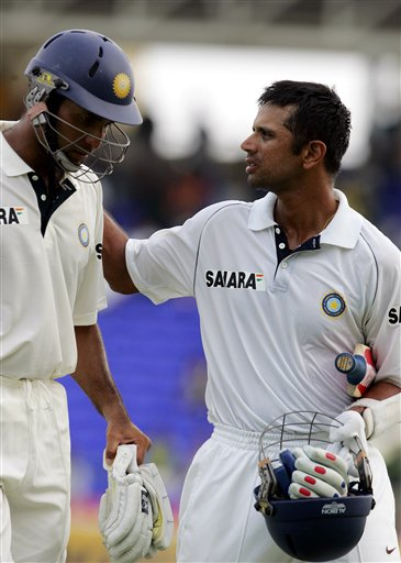India's batsmen VVS Laxman, left, and captain Rahul Dravid, right, walk off the field at the end of play on the third day of the third cricket Test match at Warner Park in Basseterre, St Kitts, Saturday, June 24, 2006. (AP Photo/Lynne Sladky)