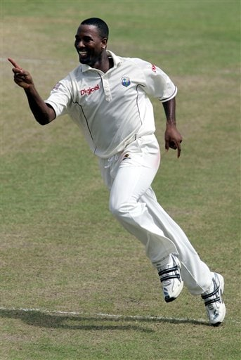 West Indies bowler Corey Collymore celebrates after taking the wicket of India's batsman Virender Sehwag for 61 for 1 on the third day of the third cricket Test match at Warner Park in Basseterre, St Kitts, Saturday, June 24, 2006. (AP Photo/Lynne Sladky)
