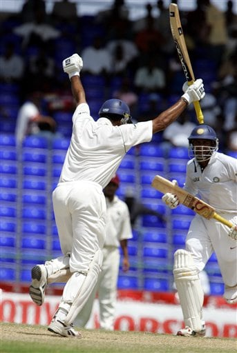 India's batsman VVS Laxman, left, celebrates after scoring a century against the West Indies on the fourth day of the third cricket Test match at Warner Park in Basseterre, St Kitts, Sunday, June 25, 2006. At right is Anil Kumble. (AP Photo/Lynne Sladky)