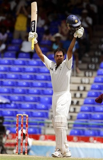 India's batsman VVS Laxman celebrates after scoring a century on the fourth day of the third cricket Test match against the West Indies at Warner Park in Basseterre, St Kitts, Sunday, June 25, 2006. (AP Photo/Lynne Sladky)