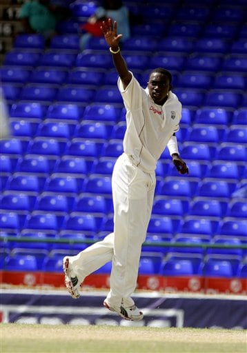 West Indies bowler Jerome Taylor celebrates after taking the wicket of India's batsman Yuvraj Singh for 157 for 3 on the fourth day of the third cricket Test match at Warner Park in Basseterre, St Kitts, Sunday, June 25, 2006. Taylor took three wickets early in the morning session. (AP Photo/Lynne Sladky)