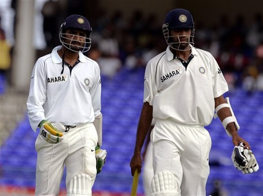 India's batsmen Harbhajan Singh, left, and Munaf Patel walk off the field after India were all out 362 for 10 in their first innings against the West Indies on the fourth day of the third cricket Test match at Warner Park in Basseterre, St Kitts, Sunday, June 25, 2006. Singh was 38 not out and Patel was caught for the final wicket. (AP Photo/Lynne Sladky)