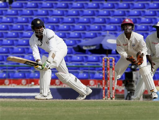 India's batsman Harbhajan Singh, left, bats as West Indies wicketkeeper Denesh Ramdin looks on during the fourth day of the third cricket Test match at Warner Park in Basseterre, St Kitts, Sunday, June 25, 2006. Singh had 38 runs not out in India's first innings. (AP Photo/Lynne Sladky)
