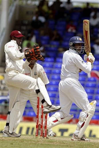 India's batsman Anil Kumble, right, bats as West Indies wicketkeeper Denesh Ramdin, left, kicks up his leg on the fourth day of the third cricket Test match at Warner Park in Basseterre, St Kitts, Sunday, June 25, 2006. Kumble scored 43 runs before being caught off the bowling of Pedro Collins. (AP Photo/Lynne Sladky)