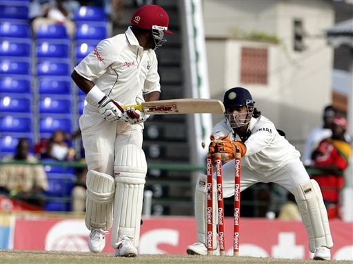 West Indies captain Brian Lara, left, looks as he is stumped by India's wicketkeeper Mahendra Dhoni, right, for 81 for 3 in the second innings on the fourth day of the third cricket Test match at Warner Park in Basseterre, St Kitts, Sunday, June 25, 2006. (AP Photo/Lynne Sladky)