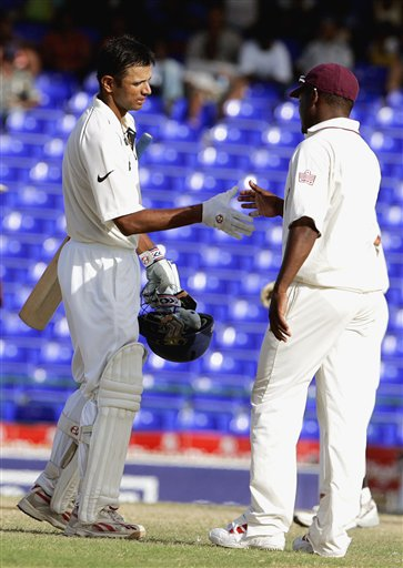 India's captain Rahul Dravid, left, shakes hands with the West Indies captain Brian Lara, right, at the end of the third cricket test match at St Kitts.