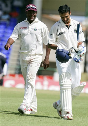 West Indies captain Brian Lara, left, walks off the field with India's captain Rahul Dravid at the tea break on the fifth day of the third cricket test match at St Kitts.