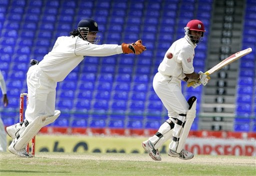 West Indies batsman Daren Ganga, right, bats as India's wicket keeper Mahendra Dhoni reaches for the ball on the fifth day of the third cricket test match at St Kitts.