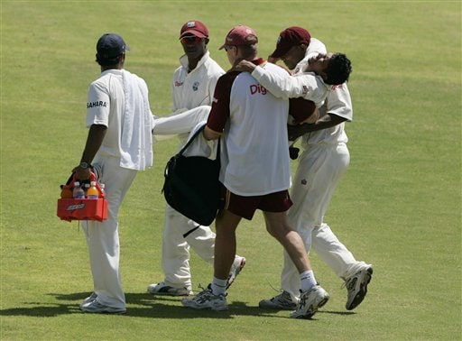 West Indies' Ramnaresh Sarwan is carried off the field after being injured while trying to make a catch during the fourth and final Test match against India at Kingston.