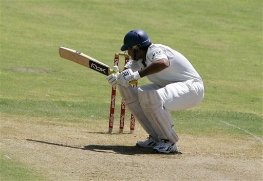 India's batsman VVS Laxman ducks to avoid a bouncer bowled by the West Indies Jerome Taylor during the fourth cricket Test at Kingston.