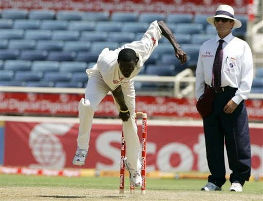 West Indies bowler Jerome Taylor, left, bowls to India during the fourth cricket Test at Kingston. Taylor had his first maiden five-wicket haul.