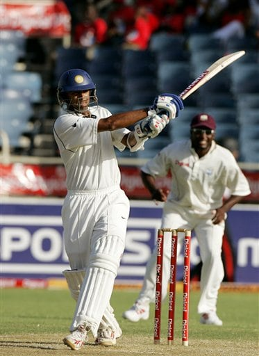 India's captain Rahul Dravid, left, hits a boundary as West Indies captain Brian Lara , right, looks on during the second day of the fourth cricket Test at Kingston