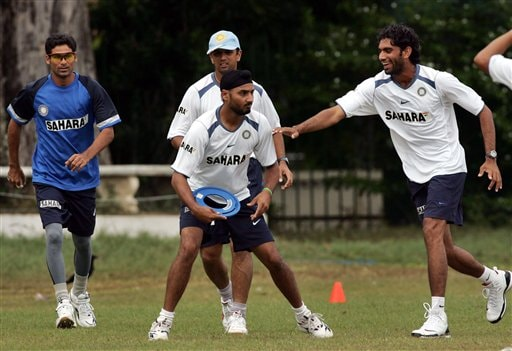 Indian cricketers, from left, Mohammad Kaif, Harbhajan Singh, Rahul Dravid, back, and Munaf Patel play Frisbee during a practice session in Colombo.