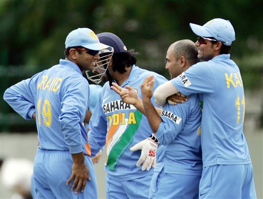 Indian cricket captain Rahul Dravid, left, shares a moment with Mohammad Kaif, right, Virender Sehwag, second right, and Mahendra Dhoni, back, during a practice match against Sri Lanka A, in Colombo.