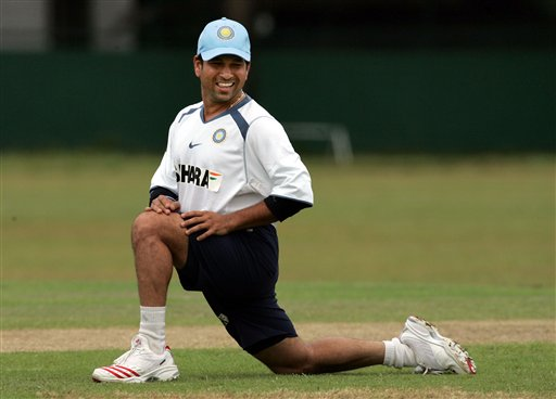 Indian cricketer Sachin Tendulkar stretches during a practice session in Colombo.