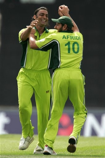 Pakistan's Shoaib Akhtar celebrates the wicket of England's Marcus Trescothick with Shahid Afridi, during the third ODI at Rose Bowl in Southampton on Tuesday.