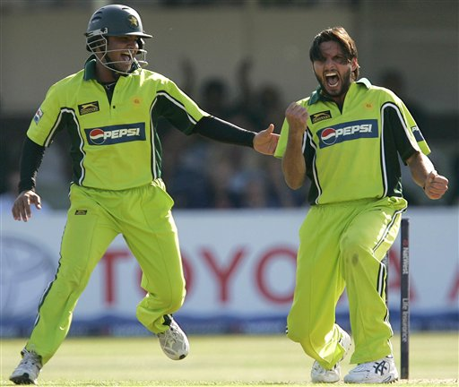 Pakistan's bowler Shahid Afridi, right, celebrates as England lose another wicket during the fifth ODI at Edgbaston on Sunday.