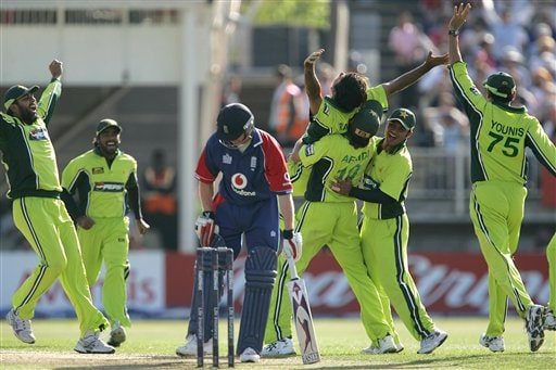 England's Paul Collingwood is given out lbw as Pakistan's bowler Abdul Razzaq, is lifted up by his team mates during the fifth ODI at Edgbaston on Sunday.
