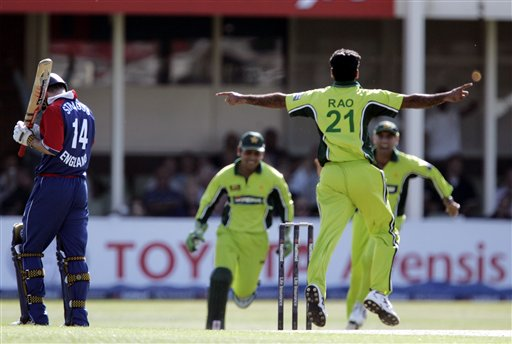 England's Andrew Strauss, left, walks off after being caught behind by Pakistan's wicket keeper Kamran Akmal, second left, as bowler Ifitkhar Anjum, second right, celebrates during the fifth ODI at Edgbaston on Sunday.